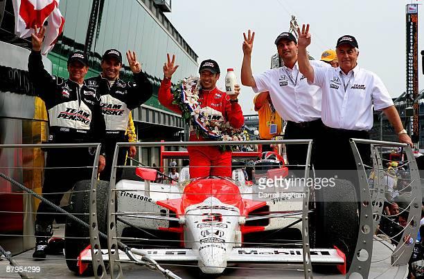 Team owner Roger Penske president of Penske Racing Tim Cimdric Helio Castroneves driver of the Team Penske Dallara Honda engineer Ron Ruzewski crew...