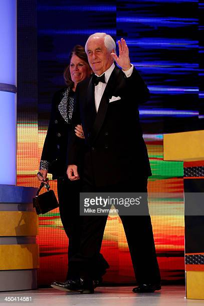 Team owner Roger Penske takes the stage with his wife Kathy during the NASCAR Nationwide Series/Camping World Truck Series banquet at the Loews Miami...
