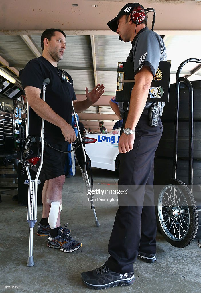 Team owner Tony Stewart talks with Chad Knaus, crew chief of the #48 Lowe's / Kobalt Tools Chevrolet, in the garage area during practice for the NASCAR Sprint Cup Series AAA 400 at Dover International Speedway on September 28, 2013 in Dover, Delaware.
