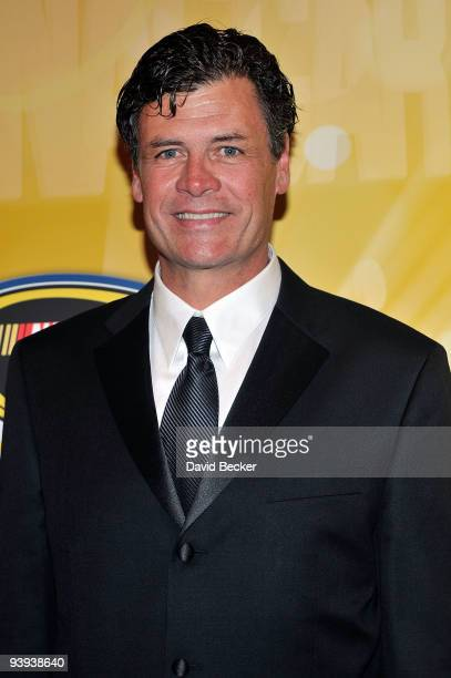 Team owner/NASCAR driver Michael Waltrip poses on the red carpet for the NASCAR Sprint Cup Series awards banquet during the final day of the NASCAR...