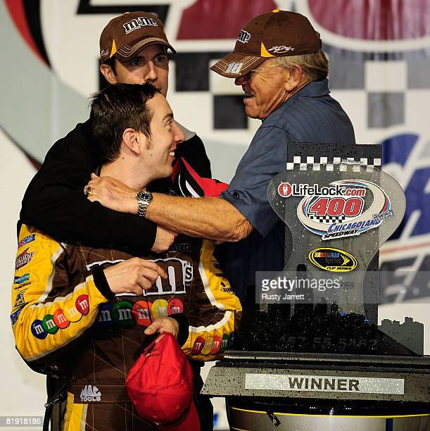 Team owners Joe Gibbs and JD Gibbs celebrate in Victory Lane with their driver Kyle Busch driver of the MMs Toyota after winning the NASCAR Sprint...