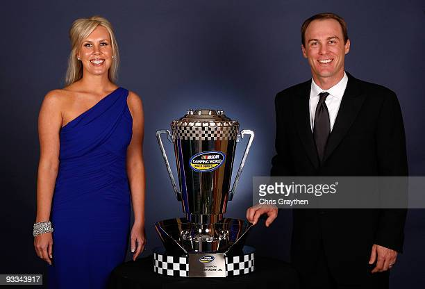 Team owners Kevin Harvick and wife DeLana Harvick pose with the 2009 Camping World Truck Series trophy during the NASCAR Nationwide/Truck Series...