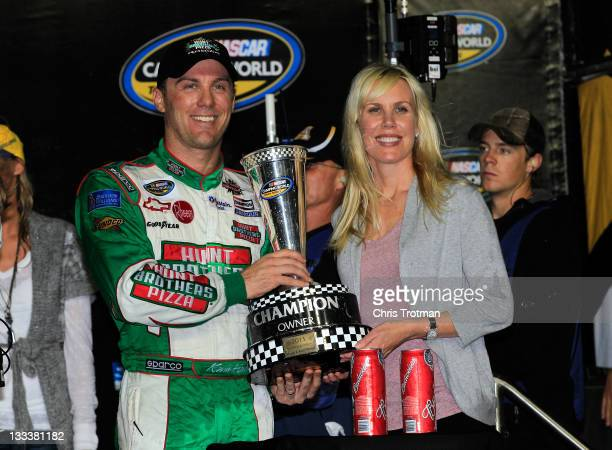 Team owners Kevin Harvick and wife DeLana pose with the 2011 owners trophy in Victory Lane after the NASCAR Camping World Truck Series Ford 200 at...