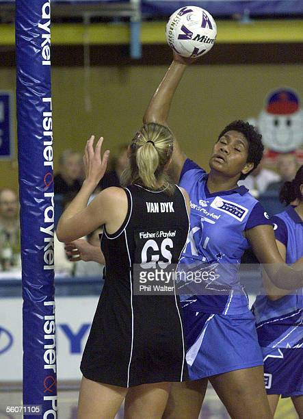 Team Pacifika's Villimaina Davu steals a pass from Silver Ferns Irene van Dyk in their Fisher and Paykel Netball match played at the ASB Stadium in...