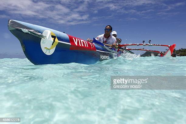 A team paddles in their Vaa a Polynesian outrigger canoe as they arrive near Matira beach in Bora Bora French Polynesia during the third stage of the...