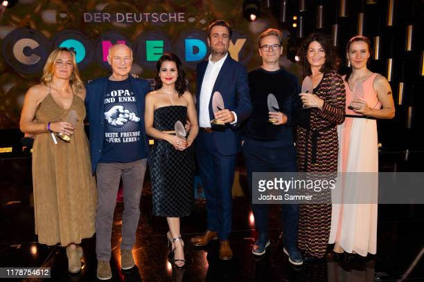 Team Pastewka poses with its awards during the 23rd annual German Comedy Awards at Studio in Köln Mühlheim on October 02, 2019 in Cologne, Germany.