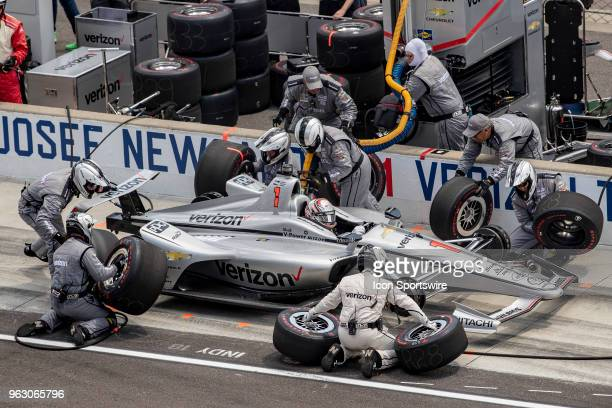 Team Penske crew members service the car of Josef Newgarden driver of the Team Penske Chevrolet during the running of the 102nd Indianapolis 500...