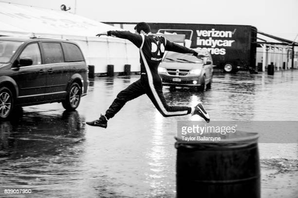 Team Penske driver Simon Pagenaud is photographed jumping over a puddle for Sports Illustrated on August 18, 2017 at Pocono Raceway, Verizon IndyCar...