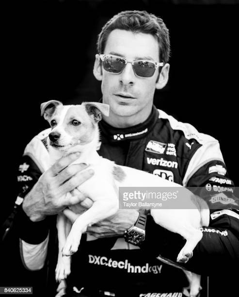 Team Penske driver Simon Pagenaud is photographed with dog Norman for Sports Illustrated on August 19 2017 at Pocono Raceway Verizon IndyCar Series...