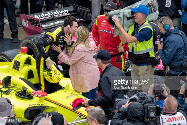 Team Penske driver Simon Pagenaud of France celebrates by kissing his fiancé Hailey McDermott after winning the IndyCar Grand Prix on May 11 at the...