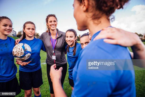 team pep talk - coach stock pictures, royalty-free photos & images