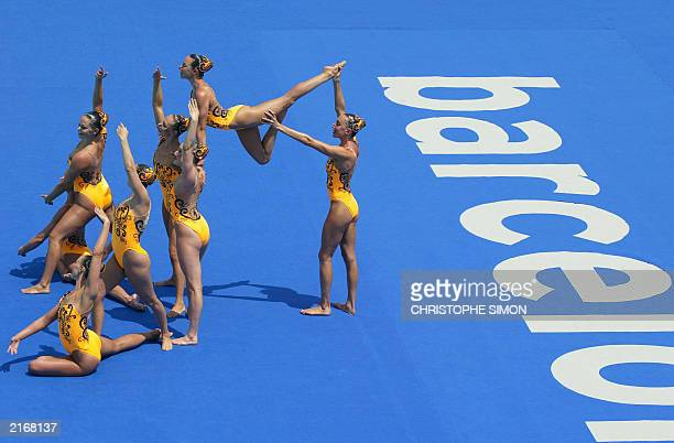 US team performs during the synchronised swimming preliminary at the 10th FINA World Swimming Championships in Barcelona 14 July 2003 Anna Kozlova...