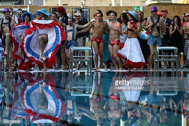 A team performs in the freestyle competition of the waterballet event on the pink friday party of the Gay Games in the western German city of Cologne...