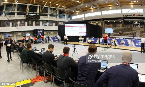 Team personnel follow the testing during the NHL Combine at HarborCenter on June 3 2017 in Buffalo New York
