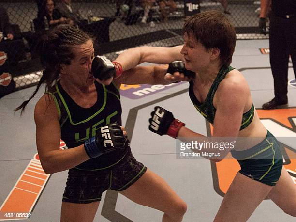 Team Pettis fighter Aisling Daly punches team Melendez fighter Angela Magana during filming of season twenty of The Ultimate Fighter on July 18 2014...