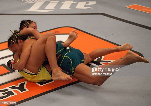 Team Pettis fighter Carla Esparza takes down team Pettis fighter Jessica Penne during filming of season twenty of The Ultimate Fighter on August 14...