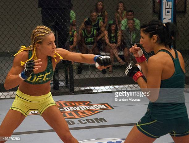 Team Pettis fighter Felice Herrig throws a punch at team Pettis fighter Randa Markos during filming of season twenty of The Ultimate Fighter on...