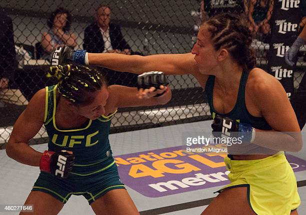 Team Pettis fighter Jessica Penne punches team Pettis fighter Carla Esparza during filming of season twenty of The Ultimate Fighter on August 14 2014...