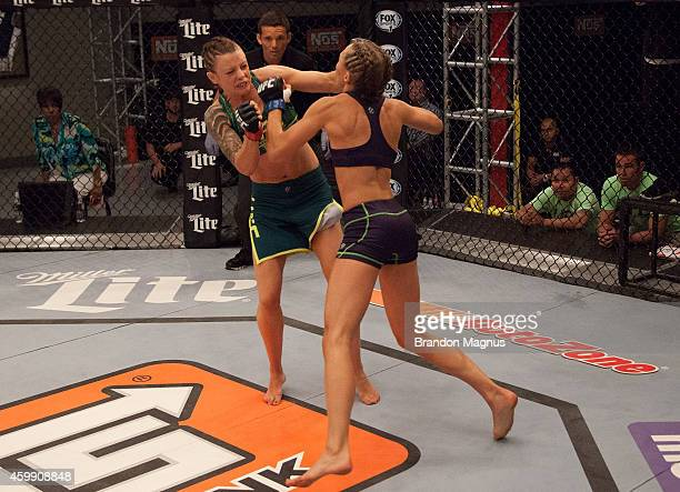 Team Pettis fighter Joanne Calderwood exchanges punches with team Melendez fighter Rose Namajunas in the quarterfinals during filming of season...