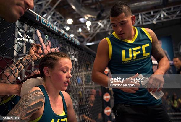 Team Pettis fighter Joanne Calderwood gets advice form Head Coach Anthony Pettis in between rounds against team Melendez fighter Emily Kagan during...