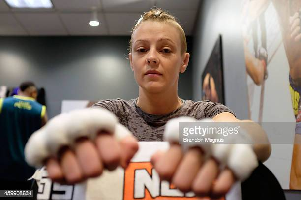 Team Pettis fighter Joanne Calderwood gets her hands wrapped before facing team Melendez fighter Rose Namajunas in the quarterfinals during filming...