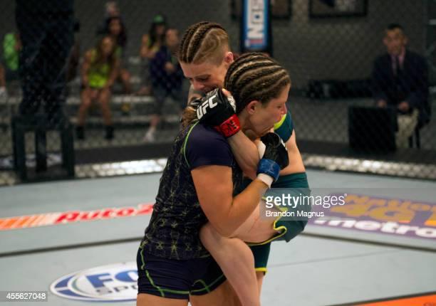Team Pettis fighter Joanne Calderwood knees team Melendez fighter Emily Kagan during filming of season twenty of The Ultimate Fighter on July 10 2014...