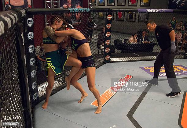 Team Pettis fighter Joanne Calderwood knees team Melendez fighter Rose Namajunas in the quarterfinals during filming of season twenty of The Ultimate...