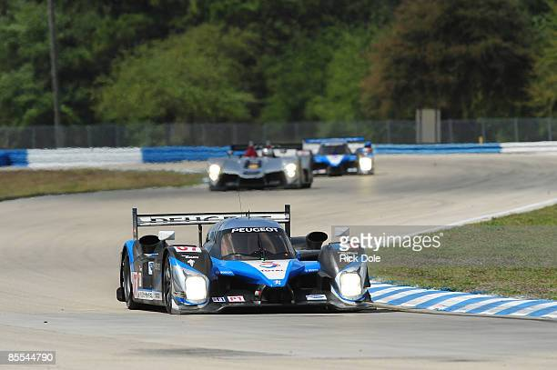 Team Peugeot 908 of Nicolas Minassian Pedro Lamy and Christian Klien leads an Audi R15 during the 57th Annual Mobil1 12 Hours of Sebring at Sebring...