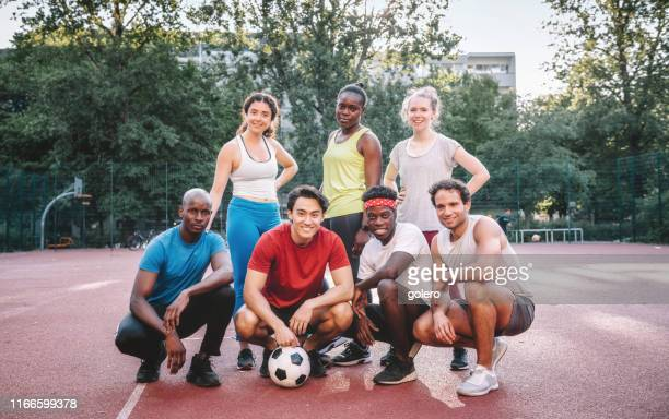 team photo of mixed soccer team on hardcourt - football team stock pictures, royalty-free photos & images