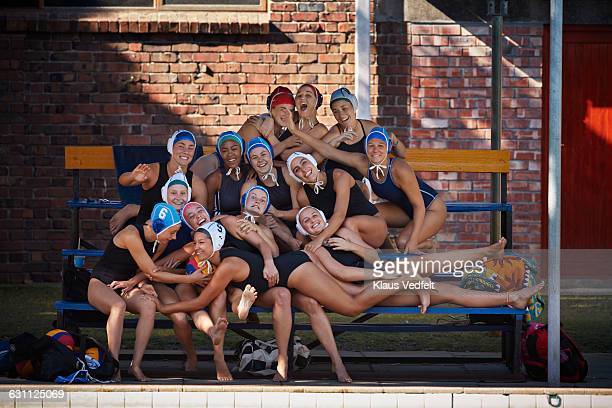 Team photo of womens waterpolo team laughing