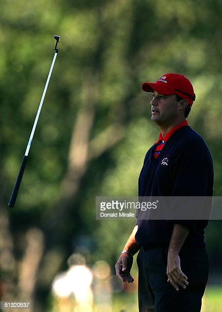Team player Chris DiMarco tosses his putter on the second green during his morning four-ball match against Sergio Garcia and Lee Westwood of Europe...