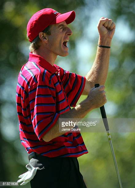 Team player Jim Furyk celebrates a birdie during his morning four-ball match against Paul Casey and David Howell of Europe at the 35th Ryder Cup...