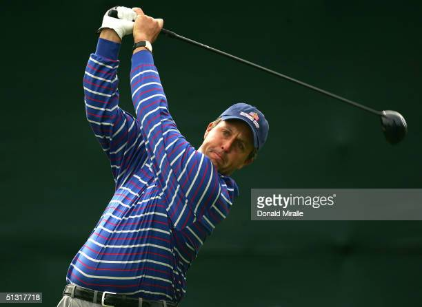Team player Phil Mickelson watches his tee shot on the 11th hole during his morning four-ball match with Colin Montgomerie and Padraig Harrington of...