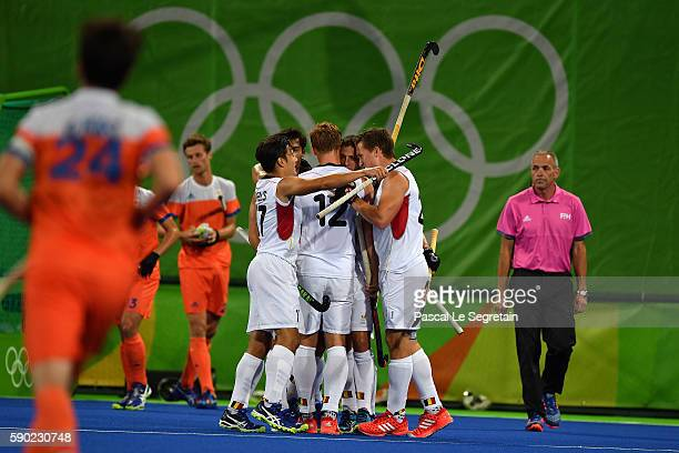 Team players of Belgium celebrate their second goal during the Men's semifinal hockey match Belgium vs Netherlands at the Olympic Hockey centre on...