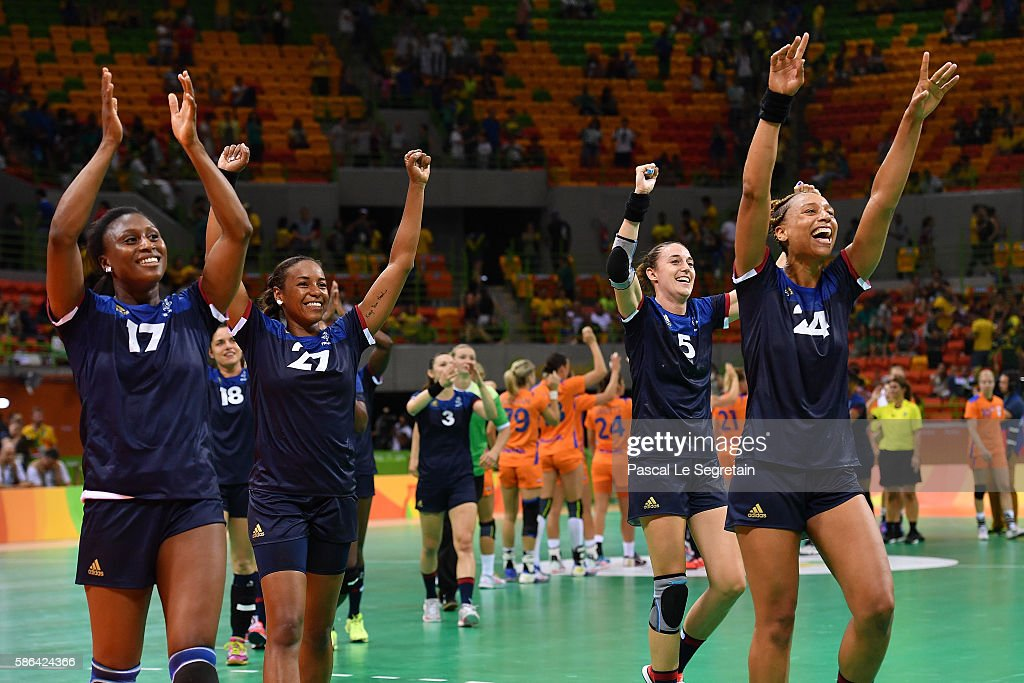 Team players of France celebrate their win after the women's preliminaries Group B handball match Netherlands vs France on Day 1 of the Rio 2016 Olympic Games at Future Arena on August 6, 2016 in Rio de Janeiro, Brazil.