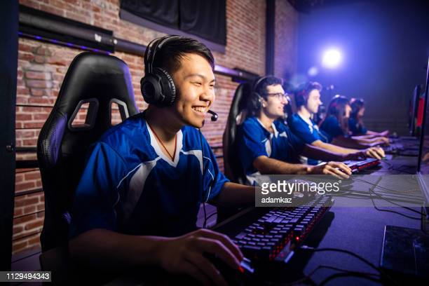 team playing esports - esports stock pictures, royalty-free photos & images