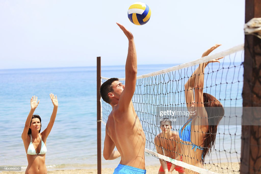 Team plays beach volleyball. : Stock Photo