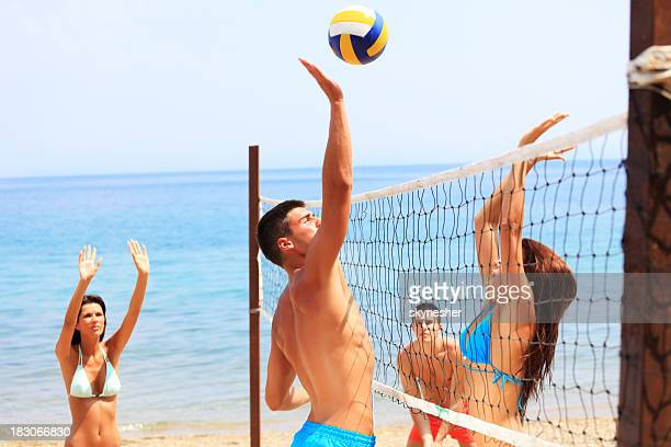 team plays beach volleyball. - beachvolleybal stockfoto's en -beelden