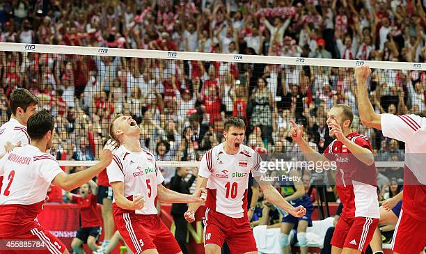 Team Poland and Mariusz Wlazly of Poland celebrate winning the World Championship match of the FIVB World Championships between Poland and Brazil at...
