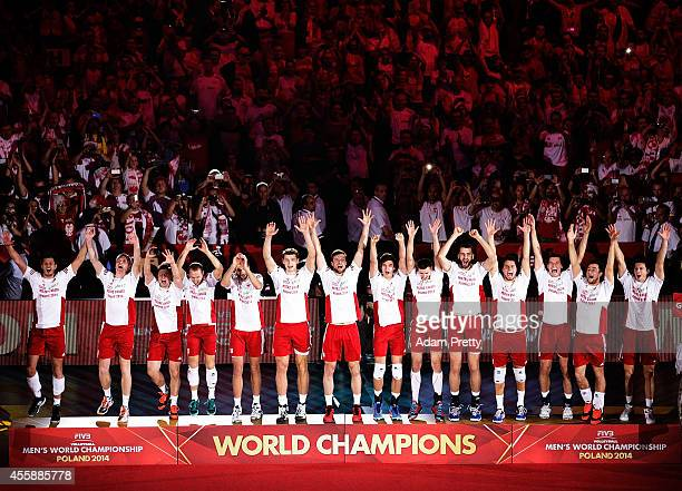 Team Poland celebrate victory after winning the World Championship match of the FIVB World Championships between Poland and Brazil at Spodek Hall on...