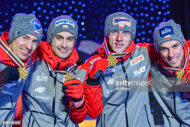 Team Poland Kamil STOCH Maciej KOT Dawid KUBACKI and Piotr ZYLA at the Awards Ceremony as they take Gold in Men Large Hill Team final in ski jumping...