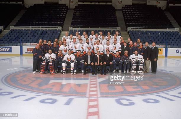 Team portrait of the 2001 2002 New York Islanders professional ice hockey team on center ice at Nassau Veterans' Coliseum Uniondale New York November...