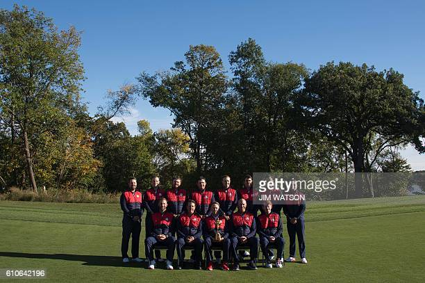 USA team poses for pictures at Hazeltine National Golf Course in Chaska Minnesota September 27 ahead of the 41st Ryder Cup Ryan Moore Zach Johnson JB...