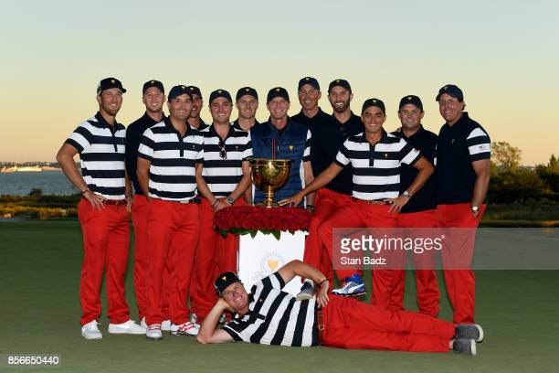 S Team poses with the President's Cup Trophy during the Sunday singles matches at the Presidents Cup at Liberty National Golf Club on October 1 in...