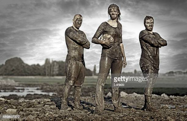 team posing for a group pic in the mud - obstacle course stock photos and pictures
