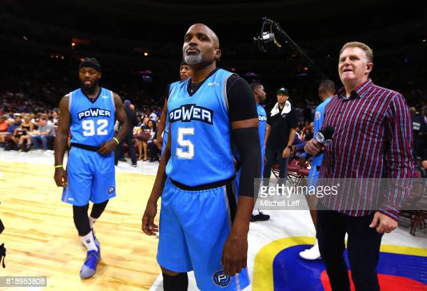 Team Power prepare for their game against the Ghost Ballers as Michael Rappaport looks on during week four of the BIG3 three on three basketball...