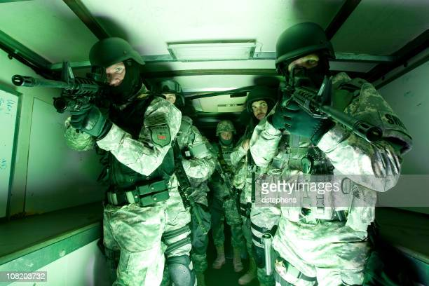 swat team preparing - swat team stock photos and pictures