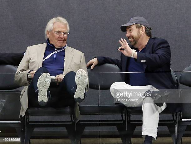 Team President Glen Sather and Exceutive Chairman James Dolan chat during the New York Rangers practice session on an off day during the 2014 NHL...