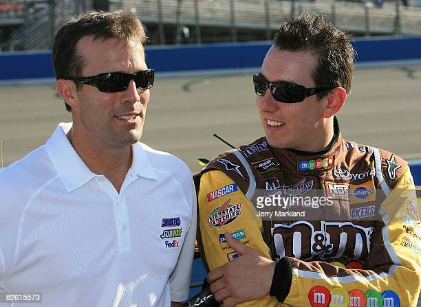 Team president JD Gibbs talks with Kyle Busch driver of the MM's prior to the NASCAR Sprint Cup Series Pepsi 500 at Auto Club Speedway on August 31...