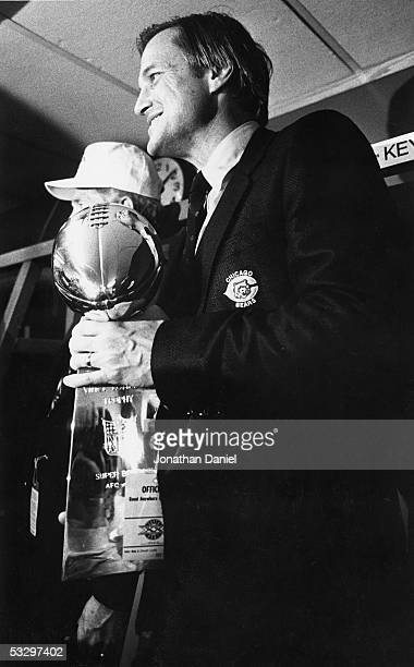 Team President Michael McCaskey of the Chicago Bears holds the Vince Lombardi Trophy in the locker room following Super Bowl XX against the New...